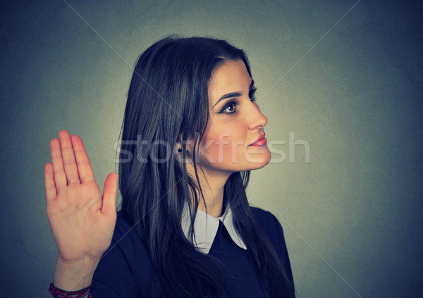 annoyed woman with bad attitude giving talk to hand gesture Stock photo © ichiosea