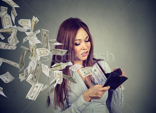 Kadın bakıyor cüzdan para dolar Stok fotoğraf © ichiosea