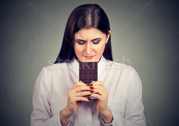 sad woman tired of diet restrictions craving sweets chocolate bar Stock photo © ichiosea