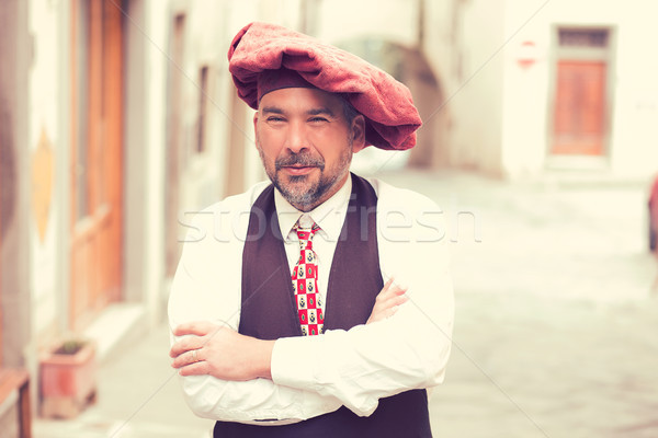 Portrait of a confident middle aged man standing outdoors on a street of an old village  Stock photo © ichiosea