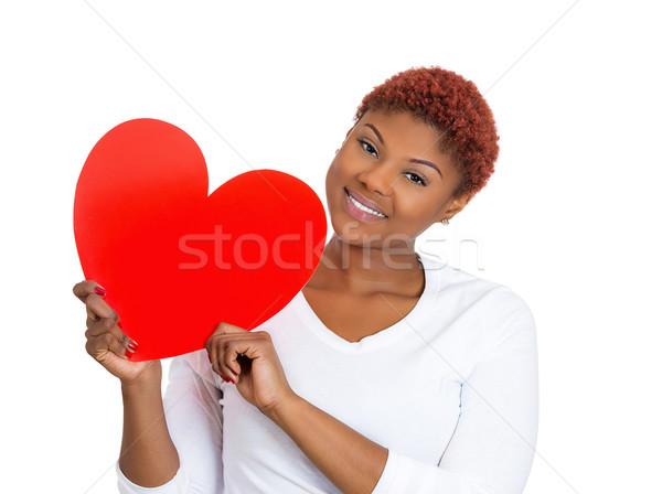 Happy woman holding heart Stock photo © ichiosea