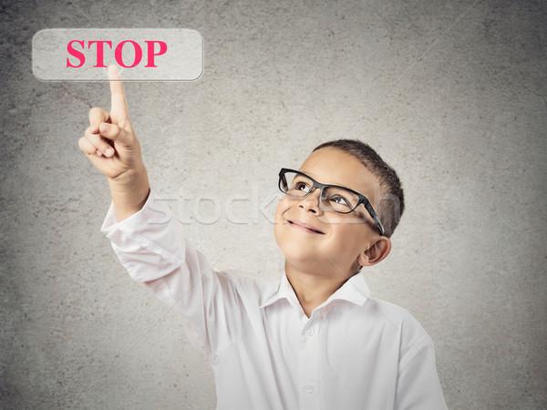 Boy clicks on Stop Button Stock photo © ichiosea