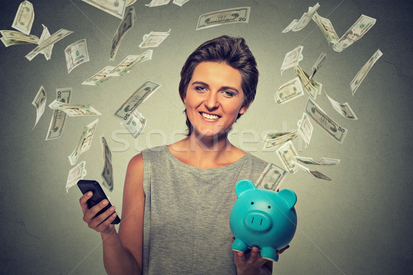 woman using smartphone with dollar bills banknotes flying away from screen Stock photo © ichiosea