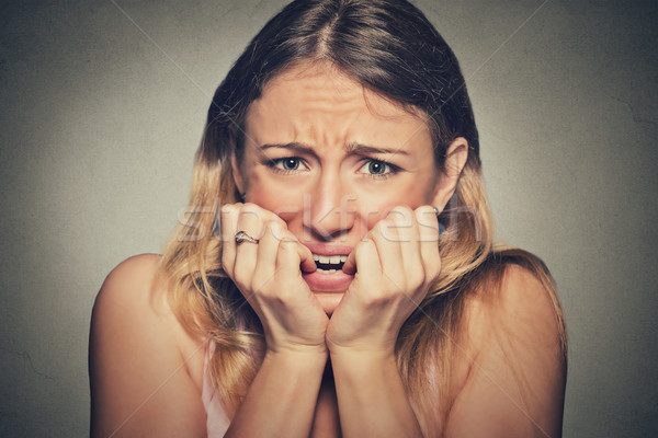 nervous stressed young woman biting fingernails looking anxiously craving Stock photo © ichiosea