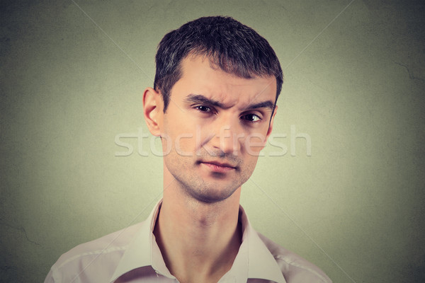 skeptical man looking suspicious, some disgust on his face  Stock photo © ichiosea