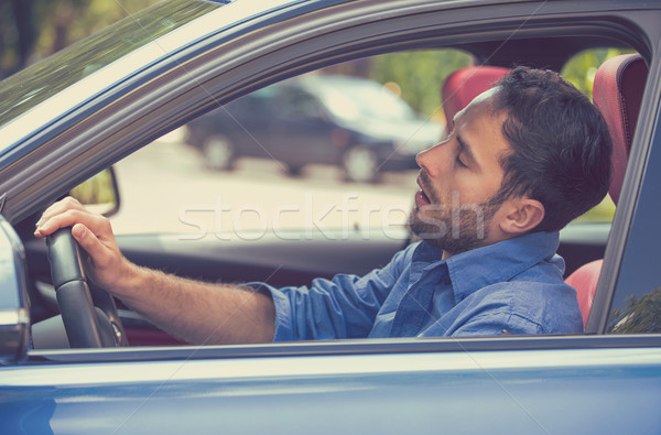 sleepy tired fatigued exhausted man driving car in traffic after long hour drive Stock photo © ichiosea
