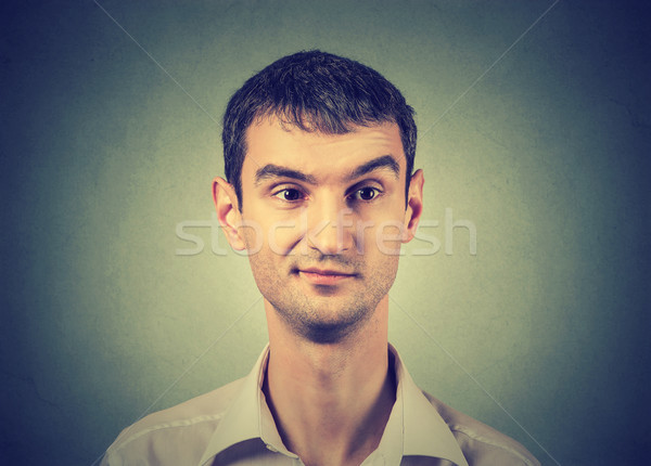 Skeptic man with an expression of discontent on his face Stock photo © ichiosea