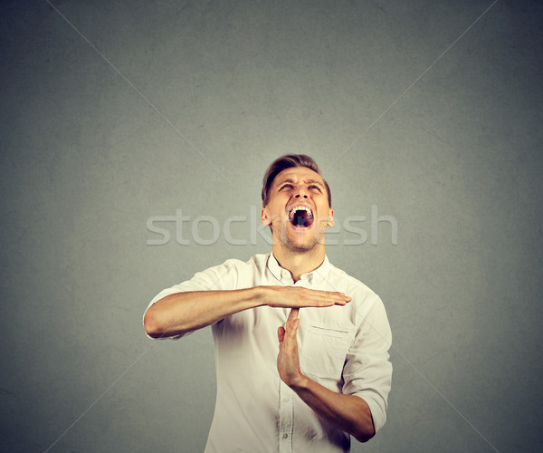 man showing time out hand gesture screaming to stop Stock photo © ichiosea