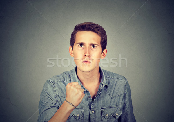 angry man with fist up  Stock photo © ichiosea