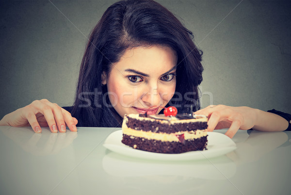 Woman craving cake dessert, eager to eat sweet food  Stock photo © ichiosea