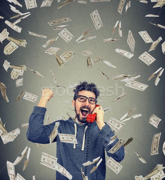 Excited man winning having phone call Stock photo © ichiosea