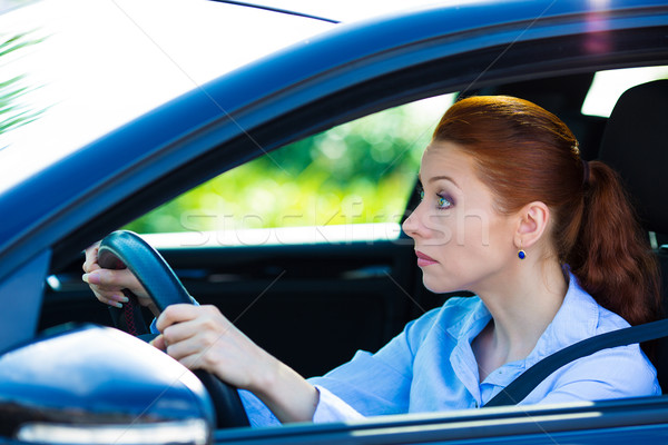 Woman falling asleep, trying to stay alert while driving Stock photo © ichiosea