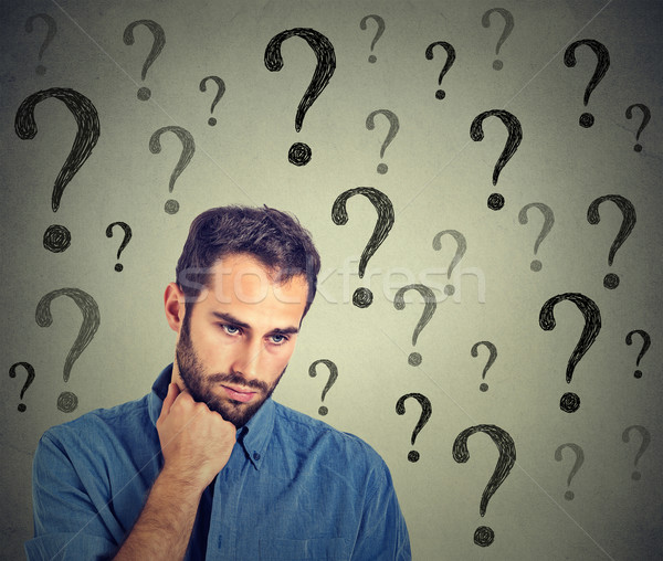 Worried sad man has many questions looking down Stock photo © ichiosea