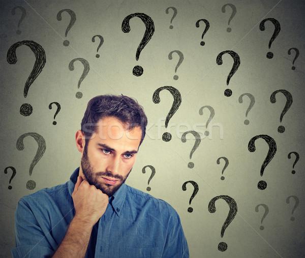 Anxieux triste homme beaucoup questions regardant vers le bas Photo stock © ichiosea