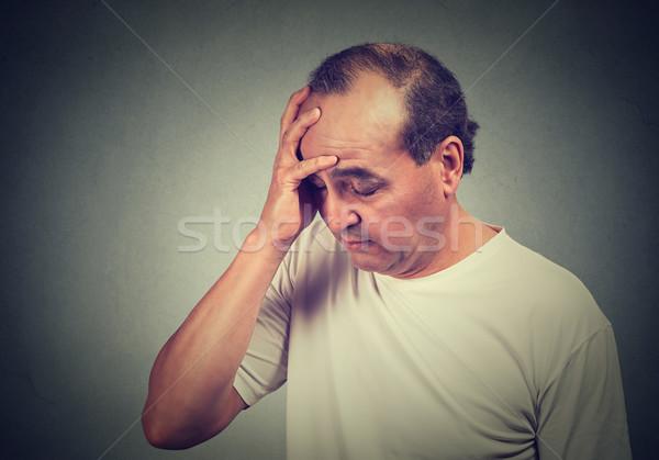 Portret w średnim wieku zdesperowany człowiek odizolowany szary Zdjęcia stock © ichiosea