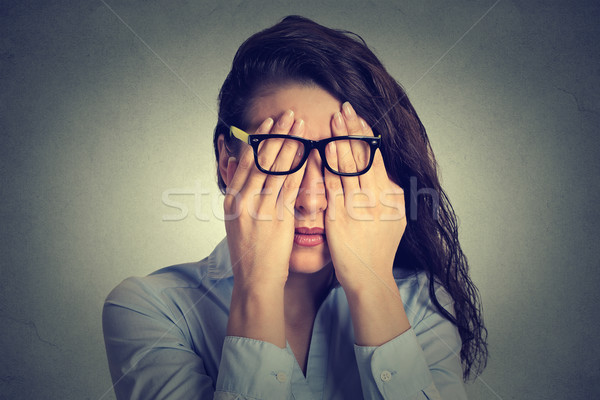 Stock photo: portrait young woman in glasses covering face eyes using her both hands