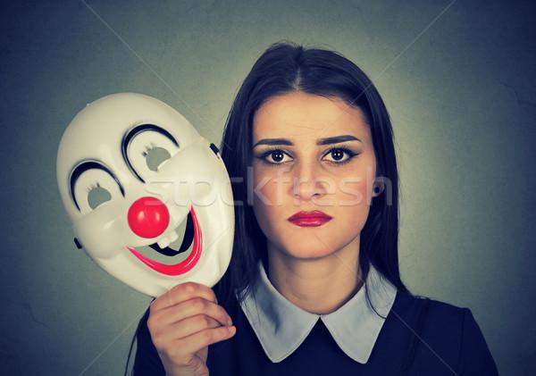 Szomorú nő tart bohóc maszk kifejez Stock fotó © ichiosea