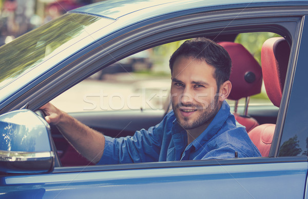 Happy man driving new car Stock photo © ichiosea