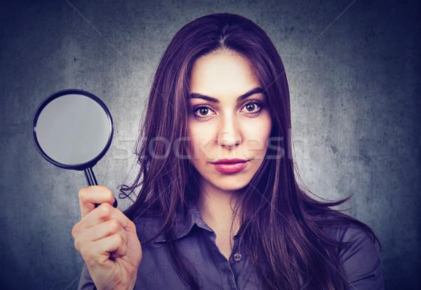 Beautiful woman with magnifying glass  Stock photo © ichiosea