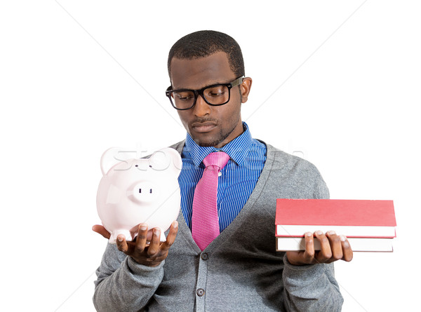 Man holding books and piggy bank Stock photo © ichiosea