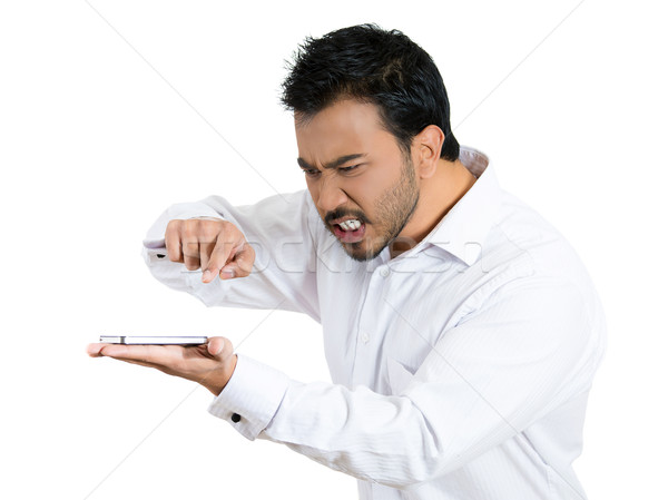 pissed off man yelling over phone Stock photo © ichiosea