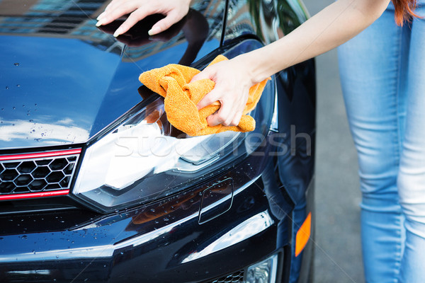 Woman cleaning , drying car with microfiber cloth Stock photo © ichiosea