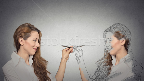 Woman drawing a picture, sketch of herself  Stock photo © ichiosea