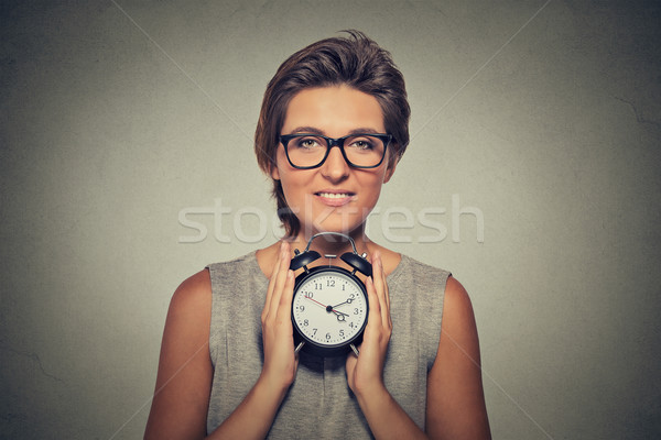 young smiling woman with alarm clock Stock photo © ichiosea