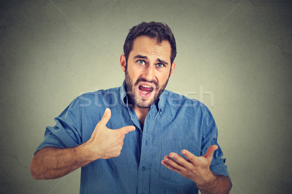 angry guy pointing at himself asking you mean me, you talking to me Stock photo © ichiosea
