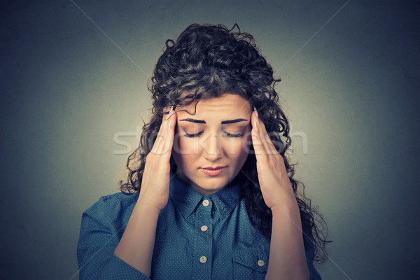 sad young woman with worried stressed face expression having headache  Stock photo © ichiosea