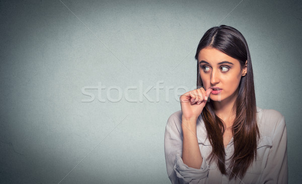 Procrastination. Confused thinking woman bewildered looking up  Stock photo © ichiosea