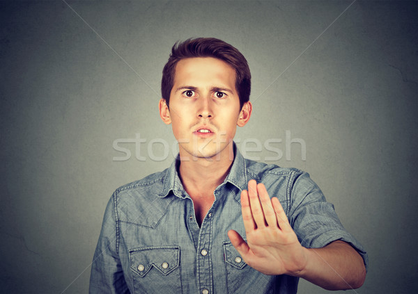Portrait disgusted angry young man with stop hand gesture Stock photo © ichiosea