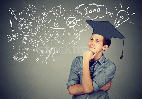 man with graduation thinking about education has many ideas  Stock photo © ichiosea