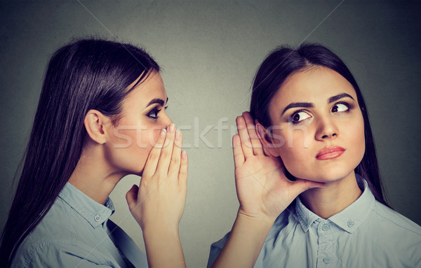 Latest rumors. Woman whispering in the ear to herself  Stock photo © ichiosea