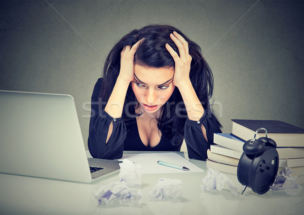 Too much work stressed woman sitting at her desk with books in front of laptop  Stock photo © ichiosea