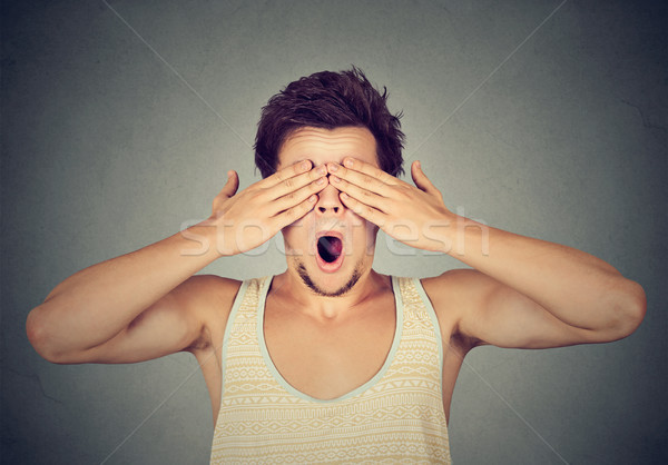 Surprised man with hands on face covering eyes  Stock photo © ichiosea