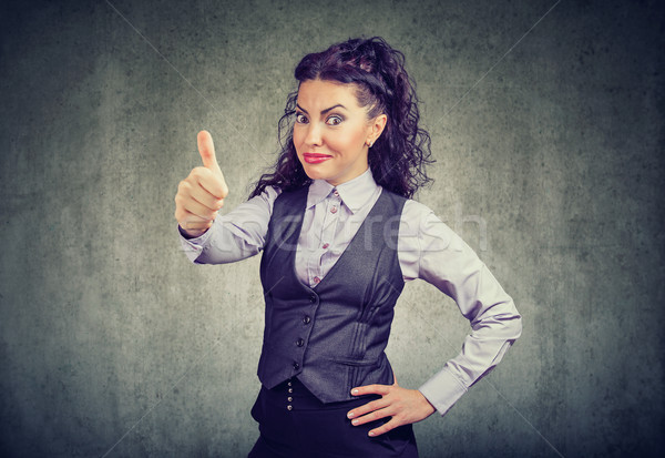 Young business woman showing thumbs up gesture Stock photo © ichiosea