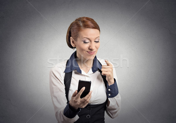 angry woman pointing with finger at smart phone Stock photo © ichiosea