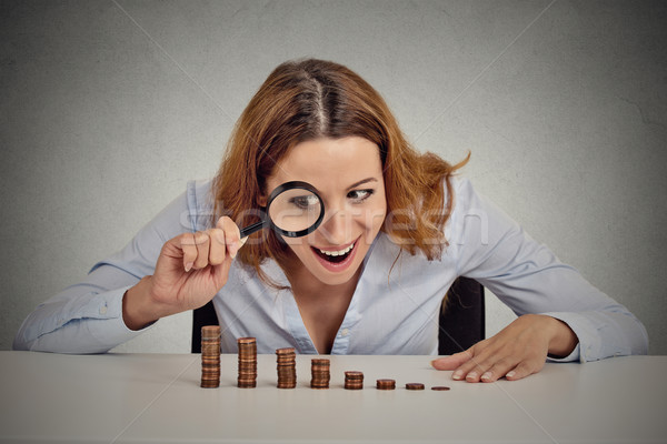 greedy business woman looking at stack of coins through magnifying glass  Stock photo © ichiosea