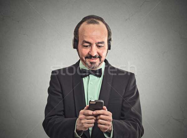 man listening music with pair of headphones Stock photo © ichiosea