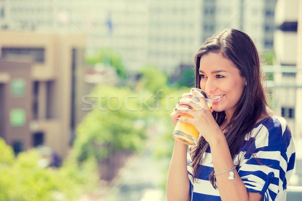 happy woman enjoying sunny day on balcony of her apartment  Stock photo © ichiosea