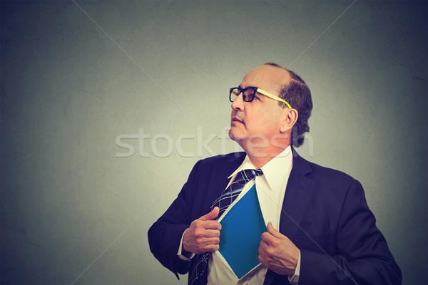 Stock photo: business man acting like a super hero and tearing his shirt off