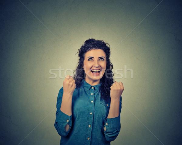 Feliz mujer extático éxito aislado gris Foto stock © ichiosea