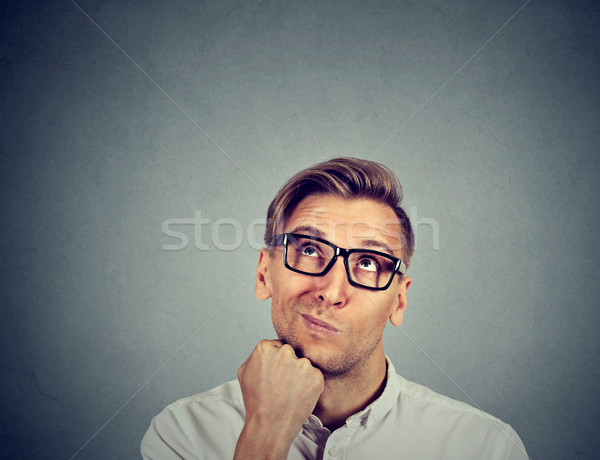 confused skeptical man thinking looking up  Stock photo © ichiosea