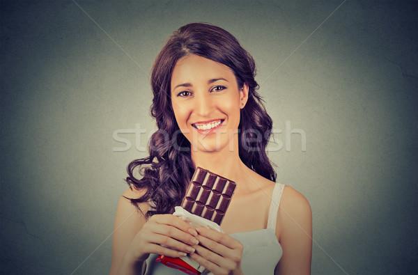 Portre genç esmer çikolata seven kadın Stok fotoğraf © ichiosea