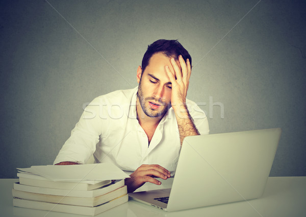 tired sleepy man sitting at desk with books laptop computer Stock photo © ichiosea