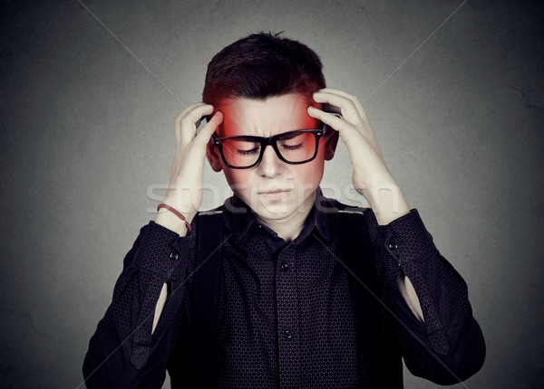 Stressed man in glasses with a headache  Stock photo © ichiosea