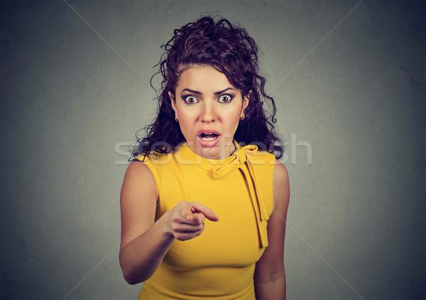 Megrémült megrémült nő mutat ujj kamera Stock fotó © ichiosea