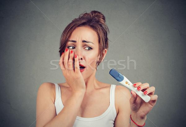 Lány ijedt pozitív terhességi teszt fiatal nő megérint Stock fotó © ichiosea