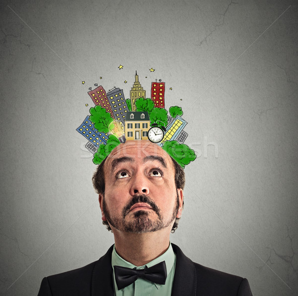 middle aged man looking up city plan above head Stock photo © ichiosea